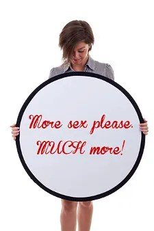 Woman with sign asking for more sex © Viorel Sima | Dreamstime.com