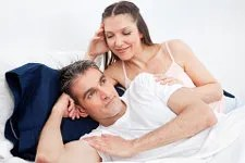 Woman trying to seduce husband © Robert Kneschke | Dreamstime.com