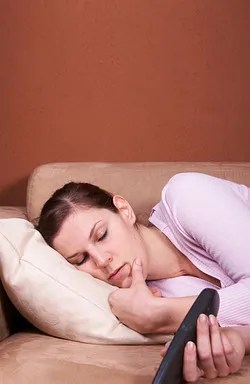 Woman asleep on couch. © Martin Allinger | Dreamstime.com