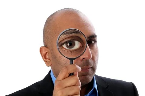 Man with magnifying glass © Riopatuca | Dreamstime.com