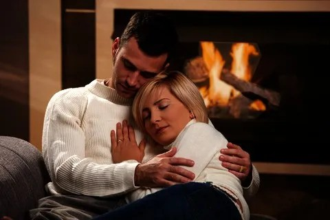 Couple by the fire © Nyul | Dreamstime.com