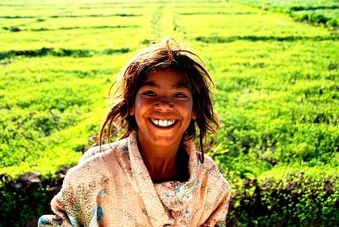 Poor and happy © Sandeep Bhandari   Dreamstime.com