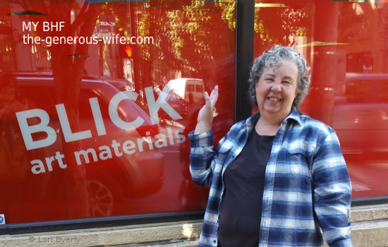 Lori standing out front of BLICK store