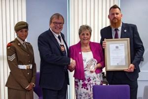Deputy Lieutenant Simon Topman MBE presents the award