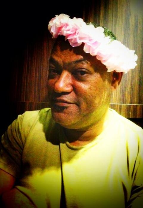 Laurence Fishburne in a floral crown