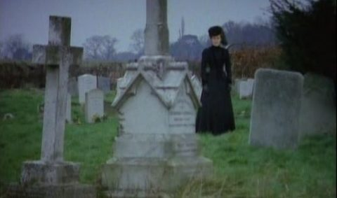 Woman in Black in the cemetery