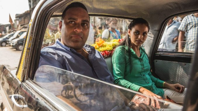 Russell Peters and Mishqah Parthiephal in The Indian Detective (Marcos Cruz/Bell Media)