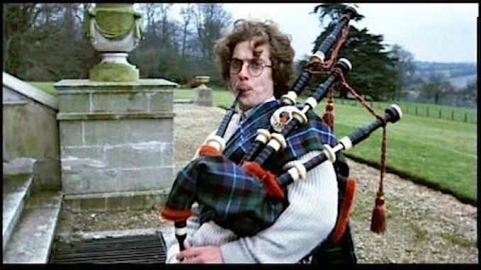 Peter Capaldi blowing the bagpipes