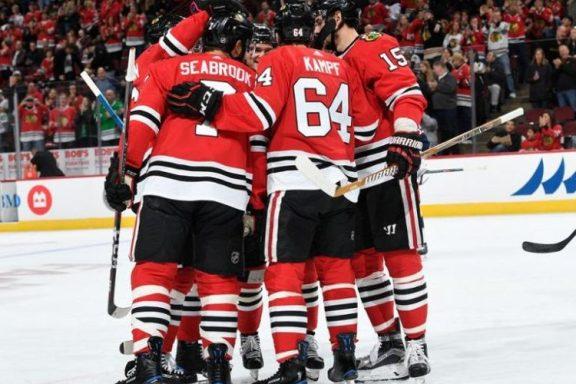 The Rink Blackhawks-Goal-Celebration-e1538656727488 The-Rink NHL Predictions for '18-19 NHL Predictions NHL Chicago Blackhawks Blackhawks