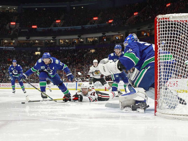 Along the Boards: Blackhawks lose a crazy game to the Canucks 7-5.