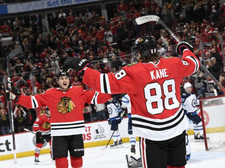 Along the boards: Hawks ground Jets, Kane is Mr. 1,000