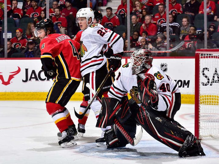 Along the boards: Blackhawks extinguish Flames in Calgary, 8–4