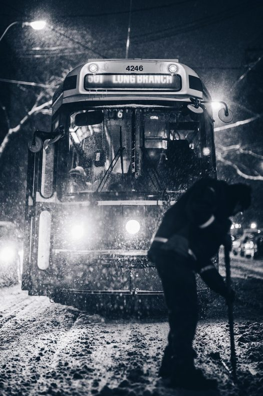 Driving Bus stuck in the snow- Scott Walsh photo - Unsplash. Driving to the mountains. Winter tyres, snow chains
