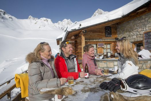 ENGADIN ST. MORITZ - . A group of three people enjoys a drink on the terrace of the Gluenetta restaurant in the Corviglia ski area in Celerina-Marguns. Copyright by ENGADIN St. Moritz By-line:swiss-image.ch/Christof Sonderegger