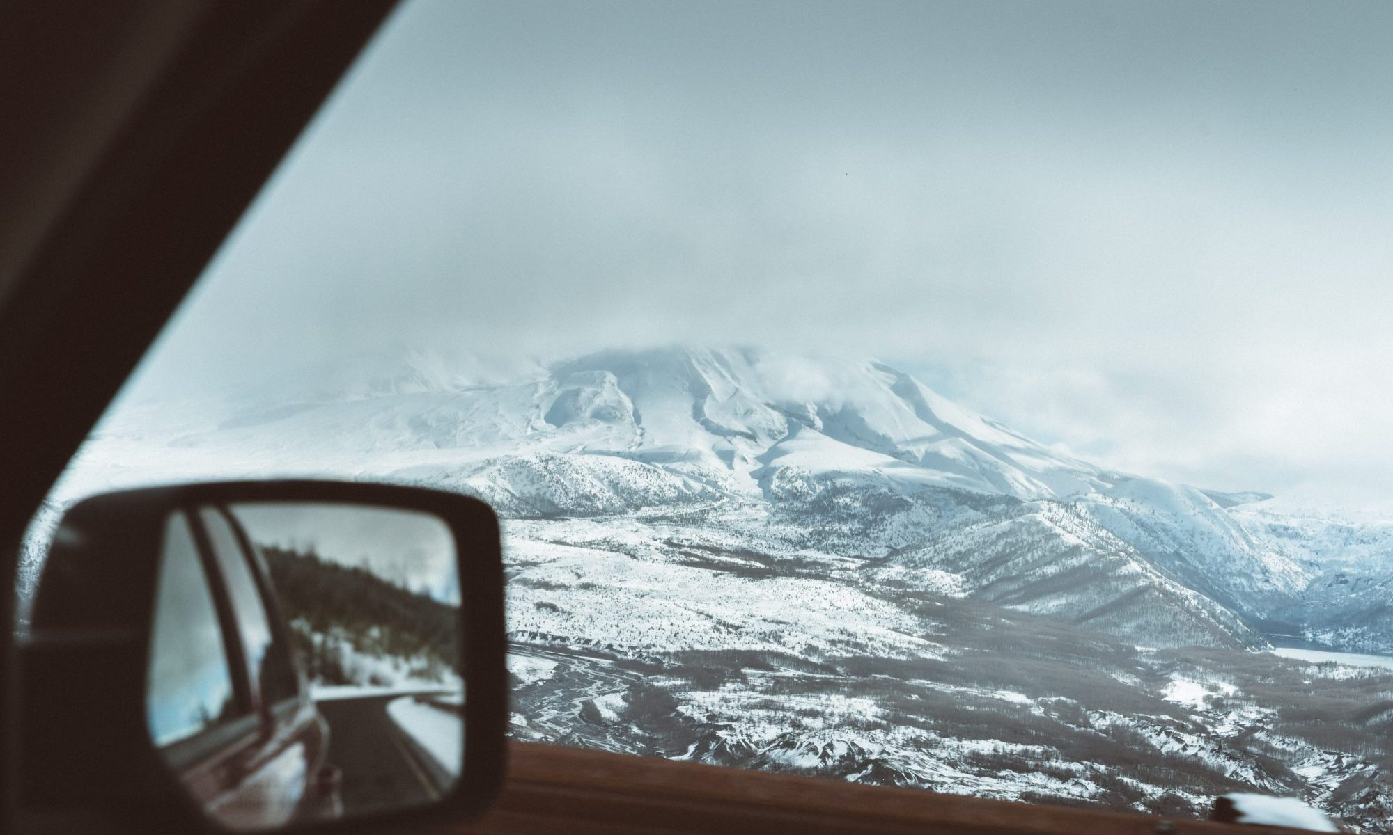 Skiers Over New Year Prepare for a £450 Wipeout at the Car Hire Rental Desk. Photo by Adrian - Unsplash - taken in Mont Saint Helens, USA.