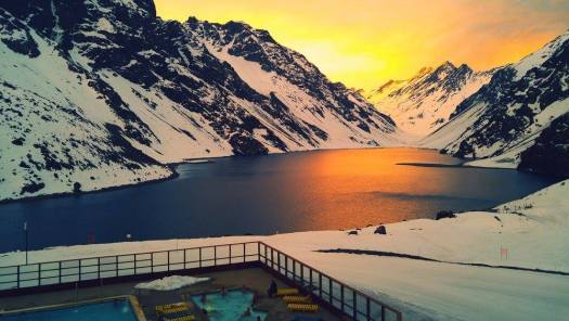Portillo at sunset - Lake Inca and the Tres Hermanos in the background - room with a view! Photo by Ski Portillo. Focus on South American Ski Resorts- High Andes: Valle Nevado, Portillo and Las Leñas – Chile and Argentina