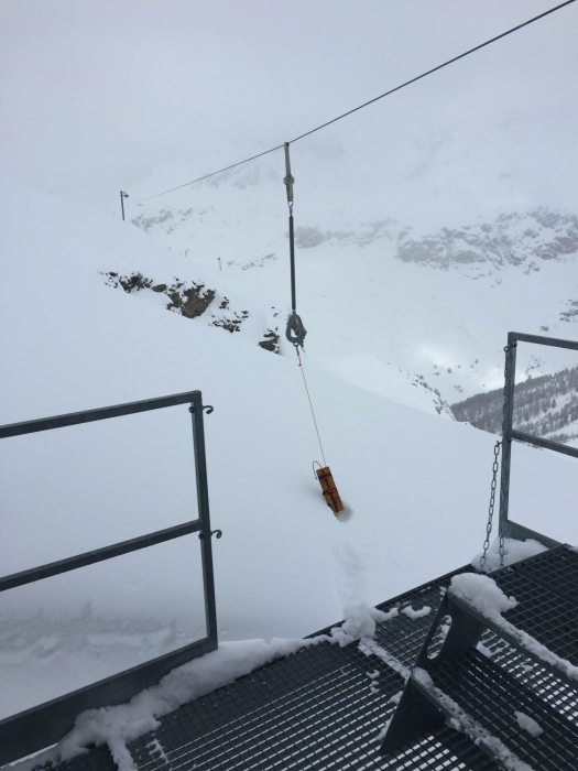 A catex in its rail out of the gare. High prone avalanche terrain