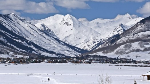 Crested Butte is one of the resorts bought by Vail Resorts. View of Gothic Mountain in the backdrop of Mount Crested Butte.