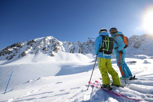 Two skiers looking at the lines they'll take off-piste. Ticiano Tozzini Photo - Pas Grau. The continuity of Grandvalira guaranteed for the long term with the addition of Ordino Arcalís to their skiing experience. - Photo: Grandvalira.