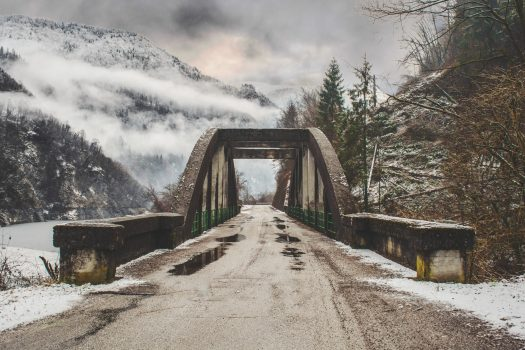 A bridge that separates you from here to your next adventure. Photo Federico Beccari- Unsplash. Self-drive skiers need to plan now for Brexit.