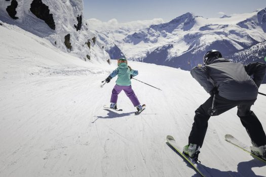 Father and daughter ski along groomed trail on top of the mountain in Whistler Blackcomb. Photo: Robin O'Neill- Whistler Blackcomb- Vail Resorts. New investments in Whistler Blackcomb to enhance the guest experience will be ready for the 2018-19 ski season.