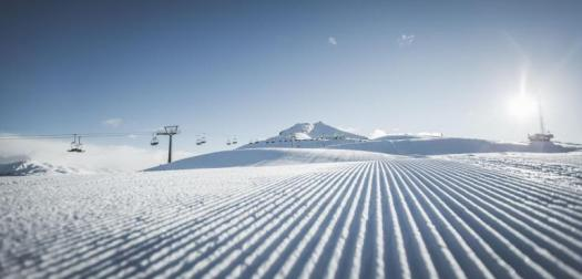 A corduroy piste at 3 Peaks Dolomites ski area - Copyright: 3 Peaks Dolomites. 3 Peaks Dolomites will link its resort to Östirol in Austria for the 21/22 ski season .