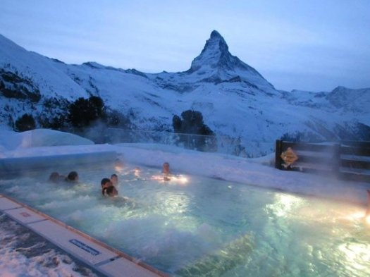 Heated outside pool at the Riffelalp Resort with a view.