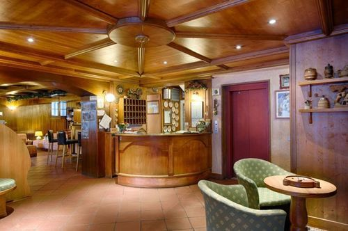 Reception area and bar at Hotel Edelweiss-Courmayeur. Where to stay in Courmayeur.