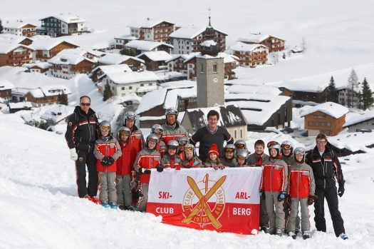 The Ski Club Arlberg posing for a group photo. Photo by Peter Mathis. Lech Zürs Tourismus. The Must-Read Guide to Lech.