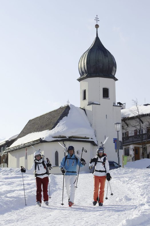 Three skiers are getting ready to hit the slopes in Lech. Photo: Peter Mathis. Lech Zürs Tourism Office. The Must-Read Guide to Lech.