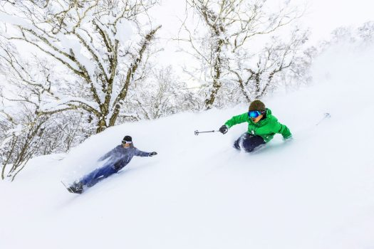 A skier and a boarder enjoying the snow in Rusutsu. Rusutsu, the Japanese Resort joins the EPIC Pass for the 2019-20 ski season.