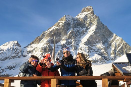 A brindis with the Monte Cervino in the background. Photo: Enrico Romanzi - Cervino Ski Paradise. Spot on Cervino Ski Paradise for the 2018-19 ski season.
