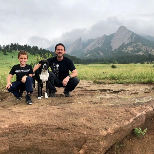 Marc Dietz with his son Ryker with the Flatirons near Boulder. Courtesy of Shred-Dog. Shred-Dog stands for High Performance Kids' Snow Gear with Incredible Value.