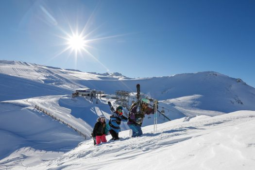 Freestyle skiers climbing up the mountain. Photo b Nils Louna. Les 2 Alpes. What is New at Les 2 Alpes this season.