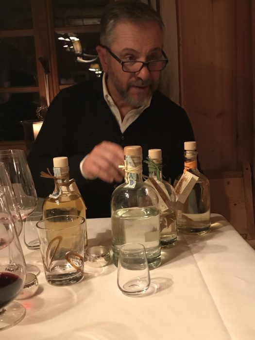 Stefano Barbini, the owner of San Lorenzo Lodges, brings some grappas to enjoy after the meal finished. Photo: The-Ski-Guru. Spot on White Deer – San Lorenzo Mountain Lodge.