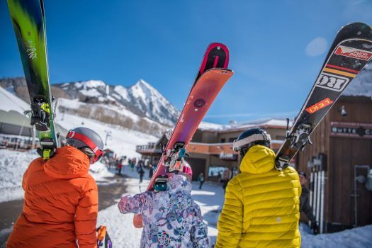Skiers walking to the base of Mt Crested Butte. Photo: CBMR. Crested Butte's Teocalli Lift Replacement Approved by U.S. Forest Service.