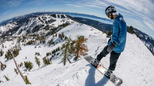 A rider is ready to take the plunge - Squaw Valley photo. Squaw Valley offering $5 passes to ski or ride in June.