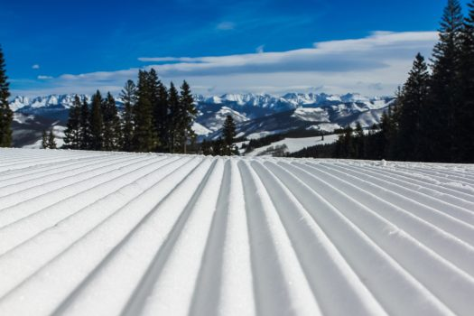 Snow Groomed. Photo by John Price. Unsplash. How can we envision ski resorts opening with social distancing for the 2020-21 ski season?