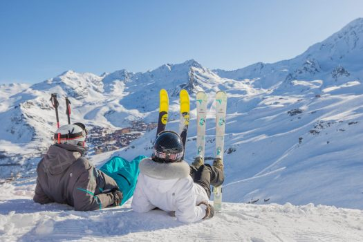 Val Thorens photo. Skiers are laying down to admire the mountains. Photo: C. Cattin OT Val Thorens. What is new for Val Thorens for 2019/20.