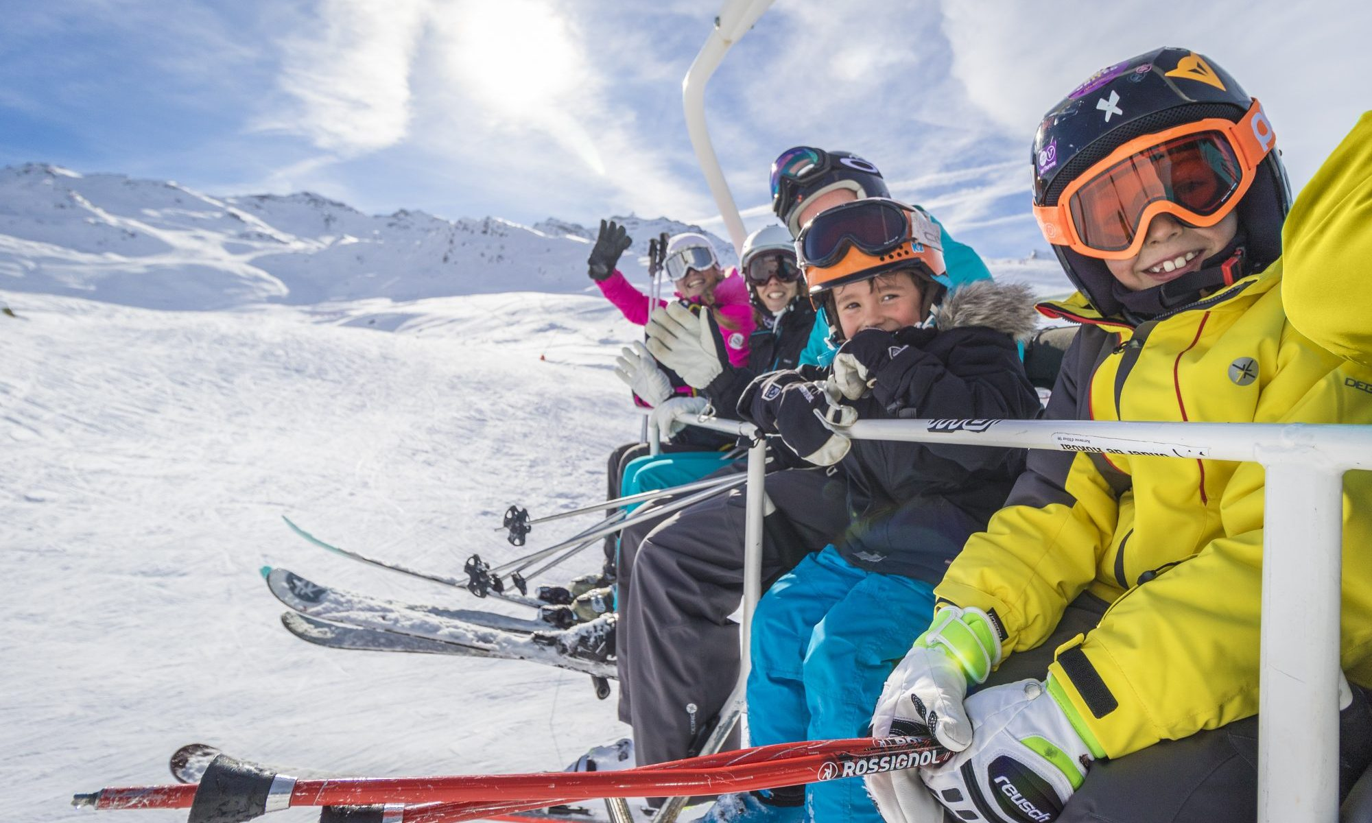 A family enjoying the pistes at Val Thorens. Photo: C.Cattin. OT Val Thorens. The COVID-19 and the domino effect closing ski resorts.