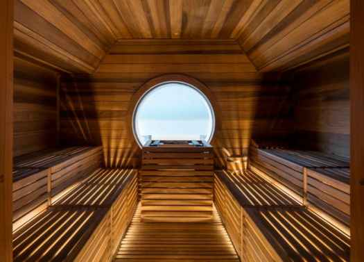 The sauna in the Faloria, with a window to the mountains. What's new in Cortina for the 2019-2020 Winter Season.