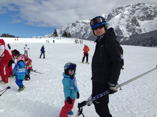 My youngest with my husband after his ski lesson in Madonna di Campiglio. 7 things that can help you when taking kids skiing.