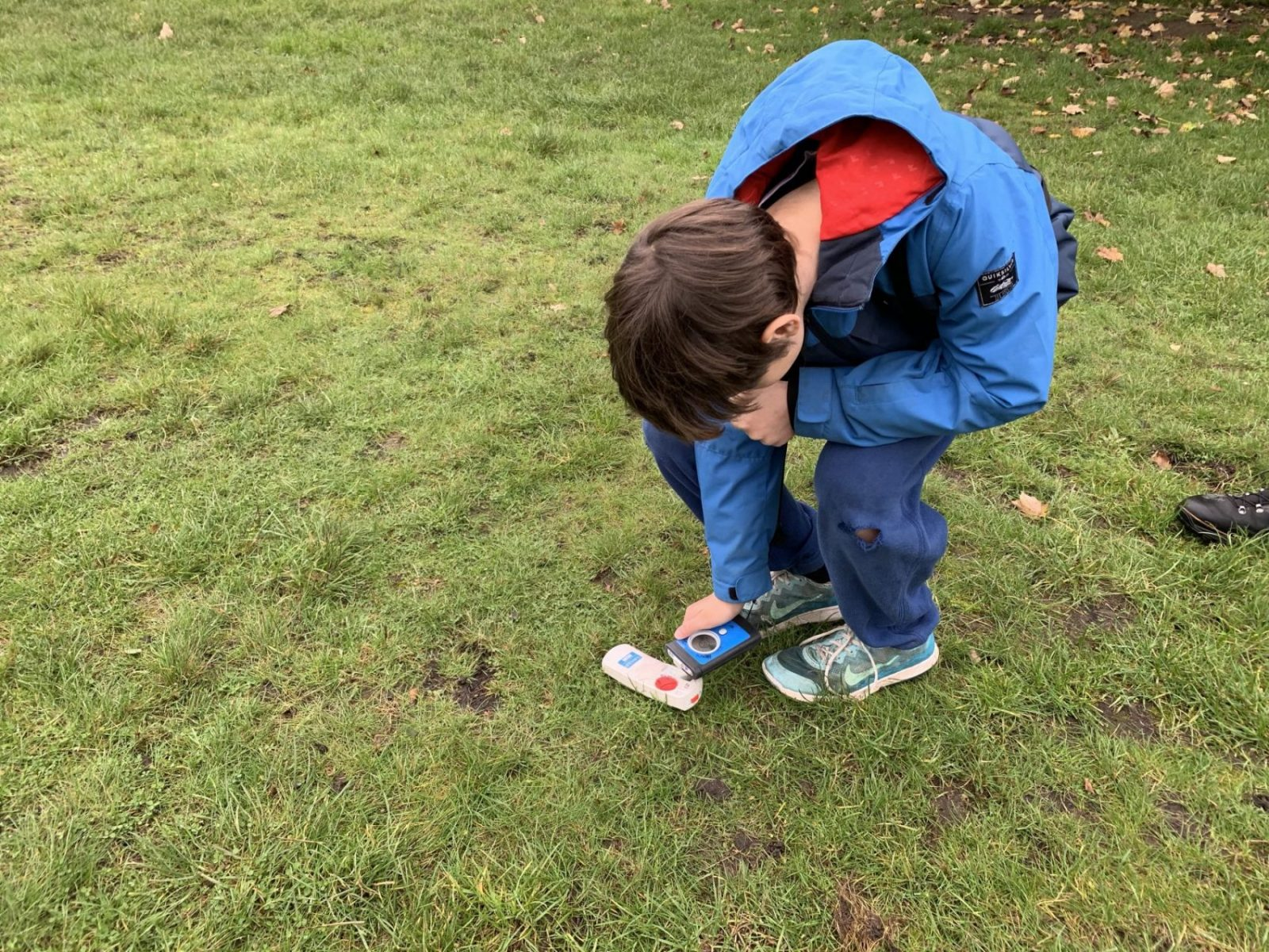 My son learning the basics of finding a transceiver on the snow. Henry's Avalanche Talk course on Wimbledon Common.
