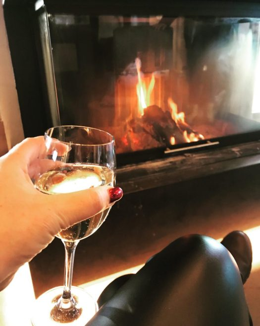 Loge du Massif. Relax with some bubbly by the fireplace. Photo Jaye Johnson. A Foodie Guide to on-Mountain Dining in Courmayeur.