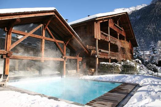 The exterior and pool of the Hameau Albert 1er. Must-Read Guide to Chamonix.
