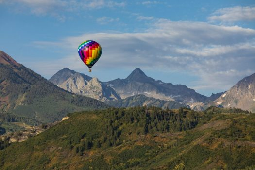 A hot-air balloon on top of the skyline. Photo: Aspen Skiing Company. Aspen Snowmass is opening for the Summer Season.