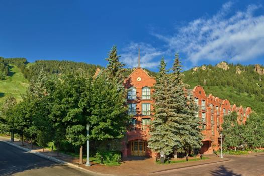 Exterior of the St Regis in Aspen, on the base of Aspen Mountain. Book your stay at the St Regis here. Aspen Snowmass is opening for the Summer Season.
