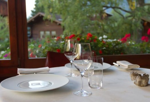 A table by the window at the Restaurant Albert 1er. Must-Read guide to Chamonix.