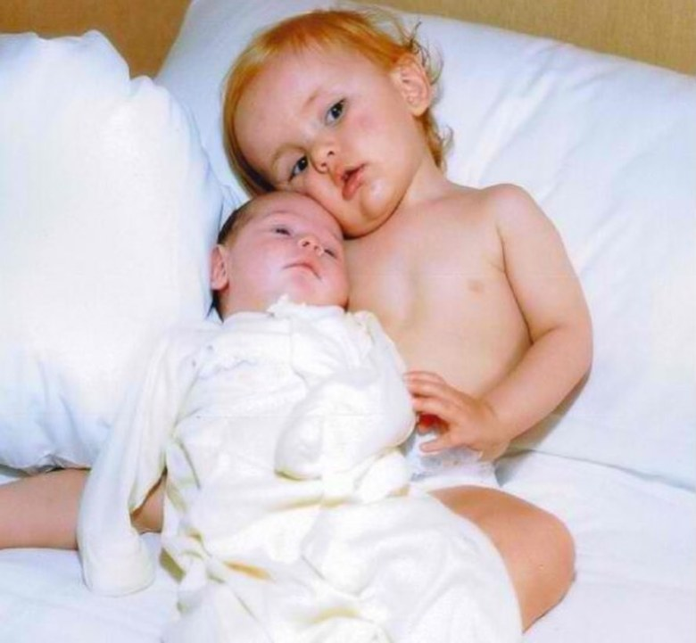 Another pic saw a toddler Prince cradling his younger sister, then a newborn, in a diaper
