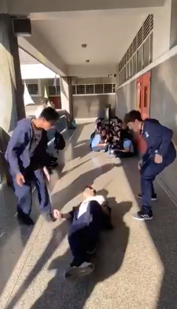 Kids fall flat on their back after receiving kicks during the sickening prank